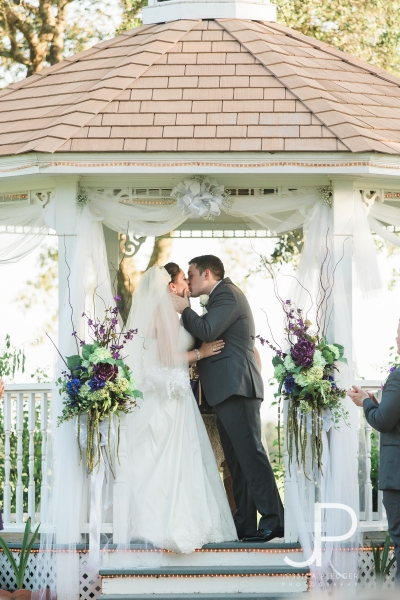 Wedding kiss at a September outdoor wedding