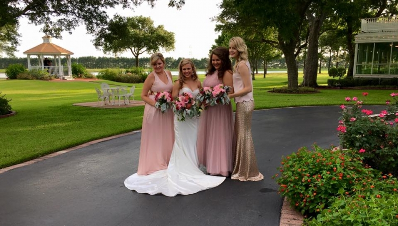 bridal party with beautiful grounds backdrop