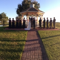 saying I do in an outdoor wedding ceremony