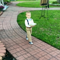 Adorable ring bearer at an outdoor wedding at House Plantation