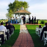 Outdoor gazebo wedding aligned with white rose petals at House Plantation
