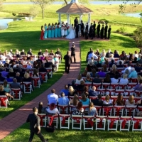 Outdoor wedding overlooking the lakes and ponds at House Plantation