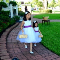 precious flower girls and their baskets full of flowers