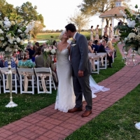 A kiss after sharing their vows at an outdoor wedding at House Plantation