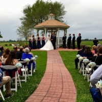 Outdoor wedding with baby breath chair decor at House Plantation