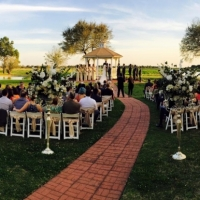 Outdoor wedding with beautiful flower aisle markers at House Plantation