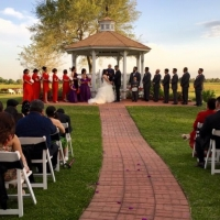 Red and black decor at an outdoor wedding at House Plantation