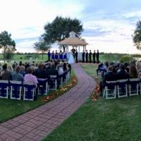 Royal blue sashes,rose petals and an outdoor wedding at House Plantation