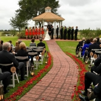 outdoor wedding at House Plantation with red rose petals