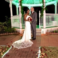 outdoor wedding with a lit up gazebo at night in december