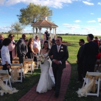 outdoor wedding with bride walking down the aisle.JPG