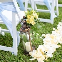 rose petals and flower aisle markers