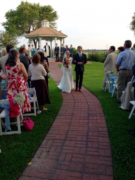 outdoor wedding and walking down the aisle in june