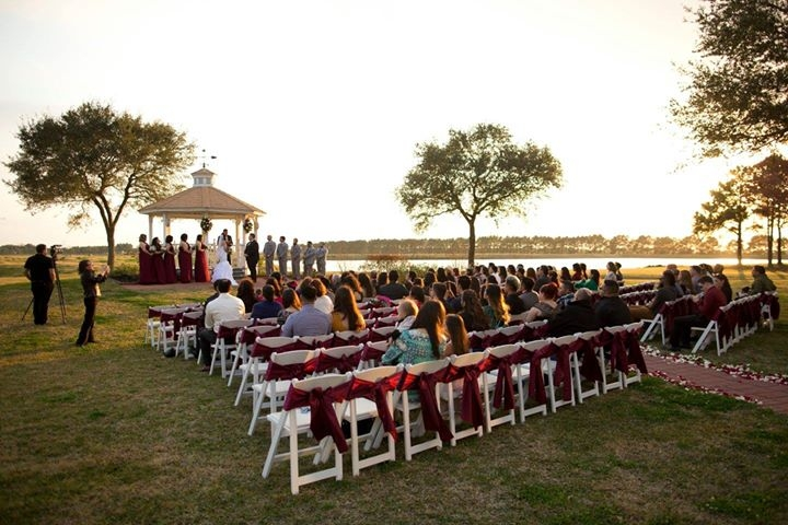 outdoor winter wedding with red sashes on the chairs