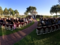 Gorgeous outdoor wedding with dark sashes in October at House Plantation