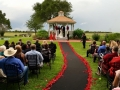 breathtaking outdoor wedding with red rose petals at House Plantation