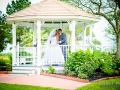 gazebo pictures in June with wedding couple