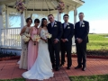 wedding party at outdoor flowered gazebo in Houston.JPG