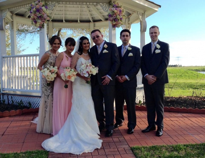 wedding party at outdoor flowered gazebo in Houston.JPG