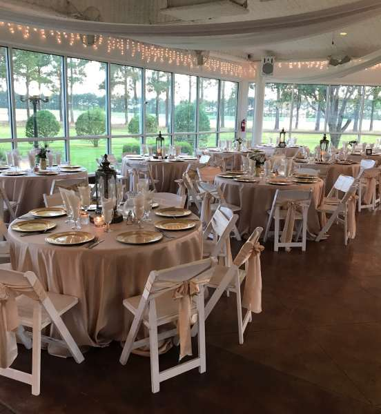 Houston-reception-tables-sprinkled-with-centerpiece-lanterns-flowers-and-candles