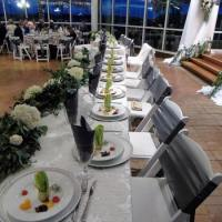Beautifully set tables with flowers and tasty appetizers