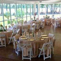 Lantern-and-flower-vase-centerpieces-at-a-House-Estate-reception