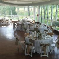 beautiful reception tables with burlap sashes at a houston wedding