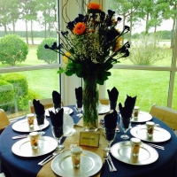 elegant reception table with vibrant flowers and gifts