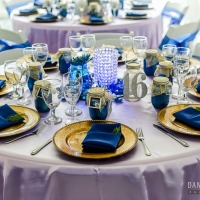 reception table in blue with gold chargers at House Estate
