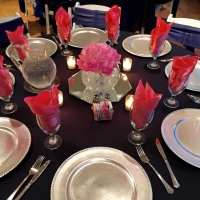 Elegantly dressed tables with candles at a reception at House Plantation