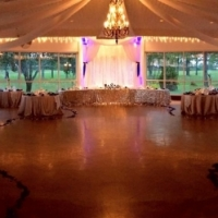 Indoor reception adorned with rose petals at House Plantation