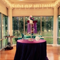 bride and groom table with decor and outdoor views
