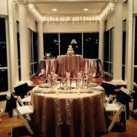 his and her table overlooking the wedding cake