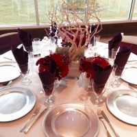 reception table with pastel colors and silver chargers