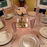 reception table with roses, mirrors and candles