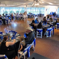 reception tables in blue with outdoor views