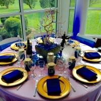 reception tables with vibrant blue decor.jpg