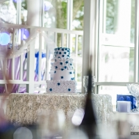 reception tables with wedding cake in Houston