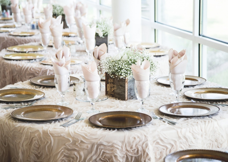 elegant reception tables with baby breaths center pieces