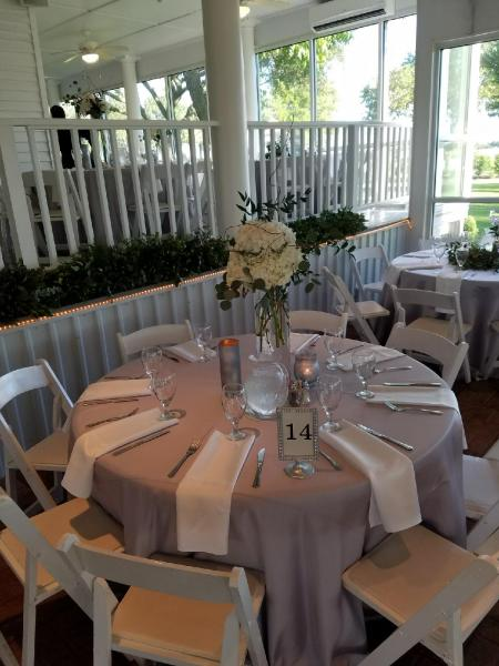 prepping-reception-tables-for-a-Houston-wedding-at-House-Estate