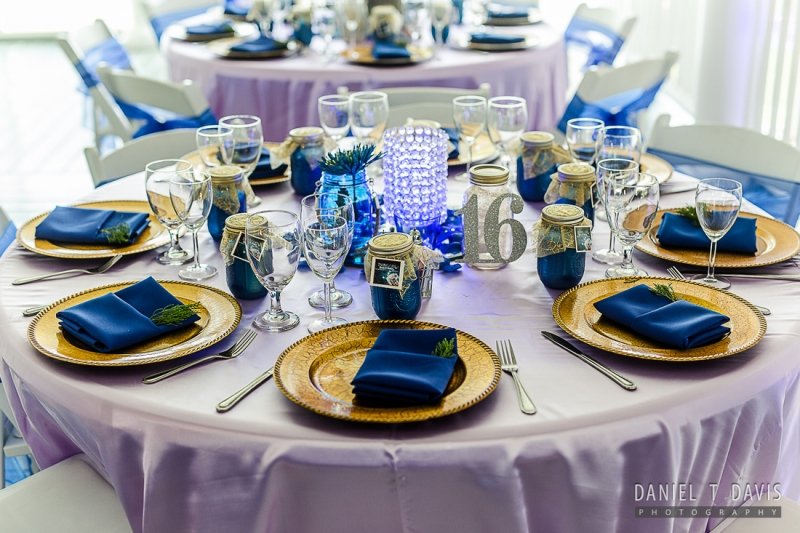 reception table in blue with gold chargers at House Plantation