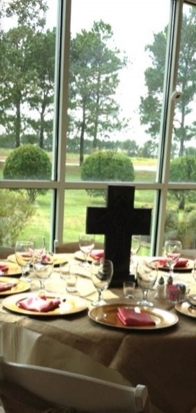 reception table with cross centerpiece