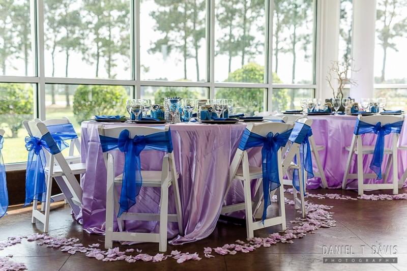 reception tables surrounded by rose petals