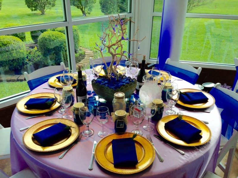 reception tables with vibrant blue decor.jpg