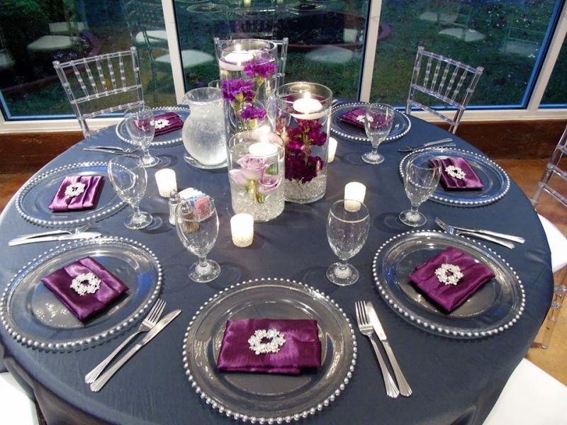 reception tables with water filled flower centerpieces
