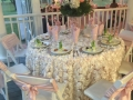 Soft pink linens and sashes at an indoor reception at house plantation