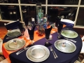 reception tabes in dark blues with water filled centerpieces