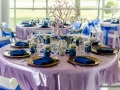 reception table set in bright blues in Houston