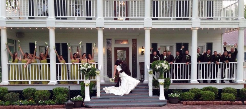 a dip at the front steps with the wedding party and bride and groom.JPG