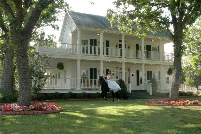 beautiful victorian mansion with horse and bride